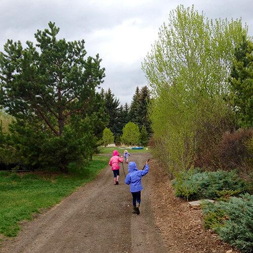 Children running down a path at Bow Point Nursery